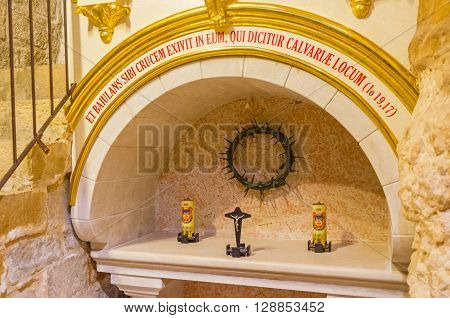 JERUSALEM ISRAEL - FEBRUARY 18 2016: The small altar at the entrance to the 7th station of Via Dolorosa - Chapel where Jesus falls the second time on his way on February 18 in Jerusalem.
