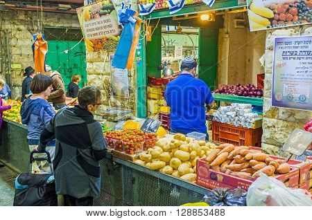 JERUSALEM ISRAEL - FEBRUARY 17 2016: The locals say that the prices and range of good is the best in Mahane Yehuda market on February 17 in Jerusalem.
