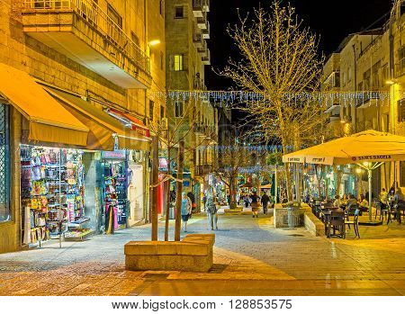 JERUSALEM ISRAEL - FEBRUARY 17 2016: The Ben Yehuda street is the part of the tourist neighborhood and offers a lot of different sovenirs in its tiny stalls on February 17 in Jerusalem.