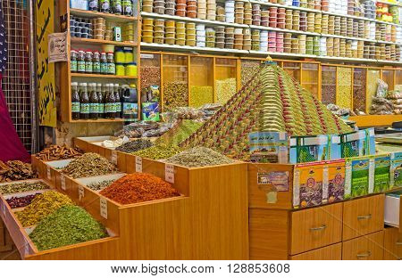 JERUSALEM ISRAEL - FEBRUARY 18 2016: The interior of the spice shop in Muslim Quarter market with the masterpiece pyramid of spices topped with the small figurine of the Dome of the Rock on February 18 in Jerusalem.