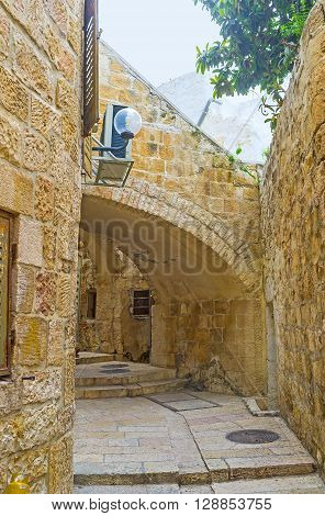 The counterforces of the residential house serve as the arches for the passage Armenian Quarter Jerusalem Israel.