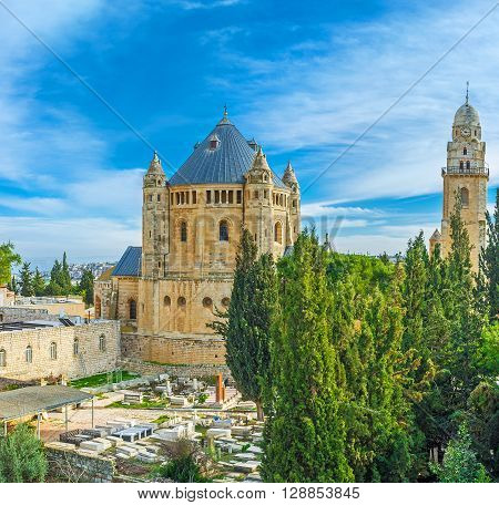 The Dormition Abbey is the notable tourist and pilgrim place on the Mount Zion surrounded by gardens and cemeteries Jerusalem Israel.