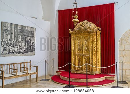 JERUSALEM ISRAEL - FEBRUARY 18 2016: The carved wooden Torah Ark covered with gilt in Istanbuli Synagogue Four Sephardic Synagogues complex on February 18 in Jerusalem.