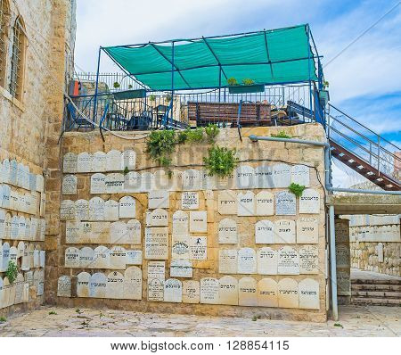 JERUSALEM ISRAEL - FEBRUARY 18 2016: The courtyard of the Holocaust museum with the ombstone-like plaques memorializing Jewish communities destroyed during the Holocaust on February 18 in Jerusalem.