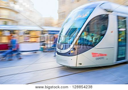 JERUSALEM ISRAEL - FEBRUARY 18 2016: The tram in motion riding along the Yafo Road on February 18 in Jerusalem.