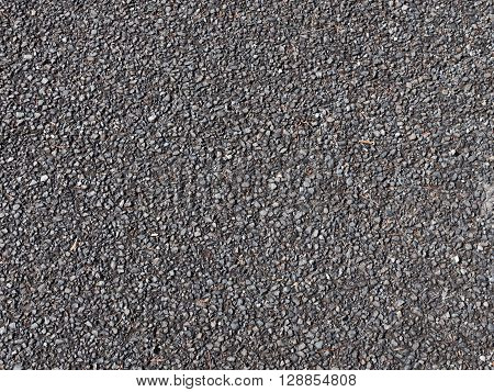 old small granite dark gray gravel on the old dirt road
