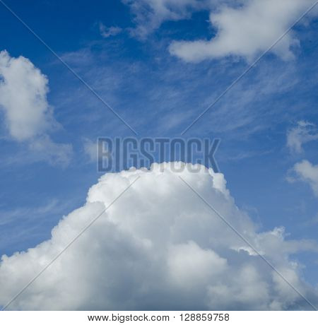 Gorgeous white cloud flying in the deep blue sky