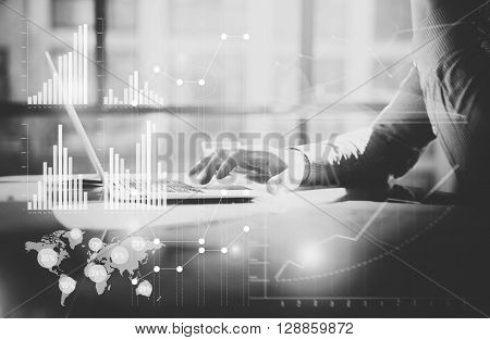 Business concept photo.Manager working table with new startup project. Man using contemporary laptop. Graphics icon, worldwide stock exchanges interfaces.Horizontal. Film effect.