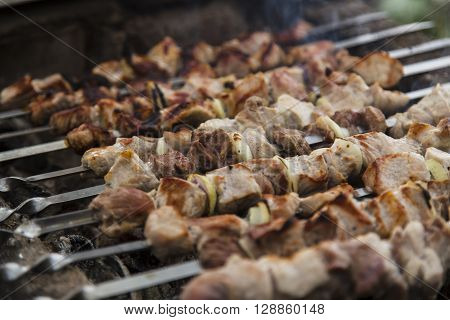 Barbecue skewers with meat on the brazier
