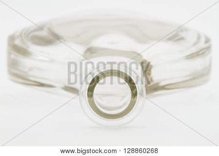 large clear glass bottle isolated on white background