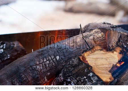 Flames and smoke from burning wood Burning firewood with ashes and flames close-up