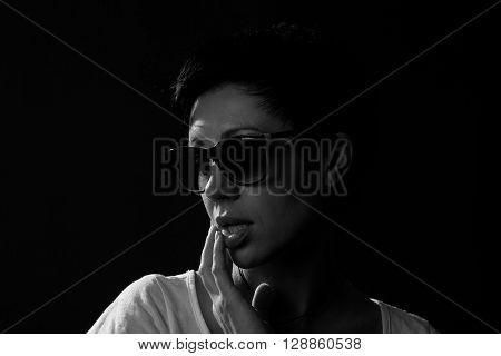 girl in sunglasses on a dark background shoot in studio Black and white sensual beautiful girl.