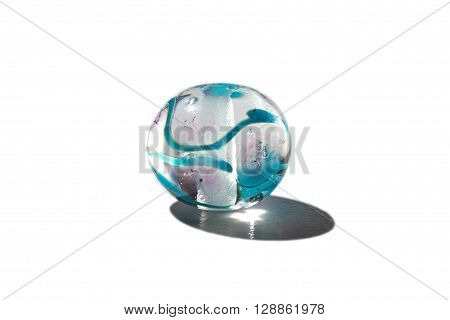 Hand made transparent with blue glass bead on white background