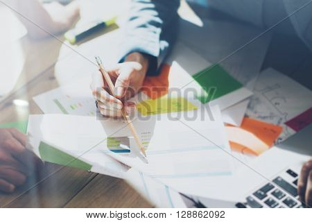 Photo team work process, signs documents table. Account managers crew works with startup project.New idea presentation, analyze marketing plans. Blurred, film effect, horizontal.