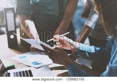 Photo team work process, holding contract hand, signs documents. Account managers young crew works with startup project.New idea presentation, analyze marketing reports.Blurred, film effect, horizontal.
