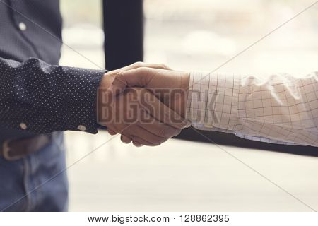 businessman handshaking for business cooperation and acquisition concept selective focus and vintage tone