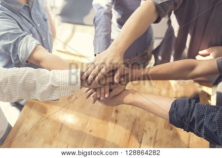 United Hands For Cooperation And Teamwork Concept