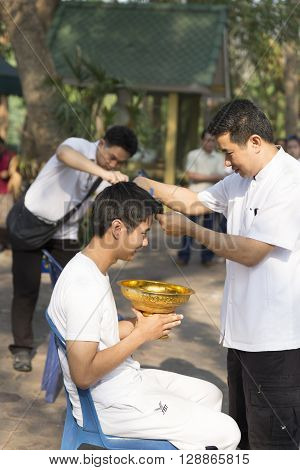 Parent Cut Hair Of Their Son Before Buddhist Monk Ordination Ceremony