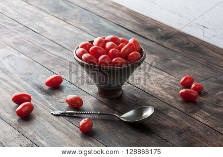 Cherry Tomatoes In Ceramic Bowl. Horizontal Image With Copy Space.