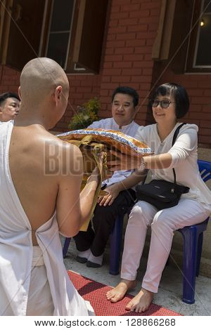 Man Receive Monk Robe From Their Parent In Buddhist Monk Ordination Ceremony