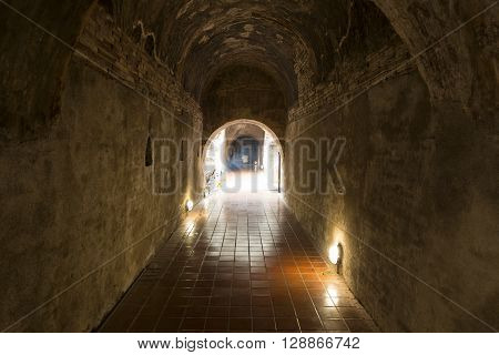 Golden Buddha Statue In Cave Tunnel
