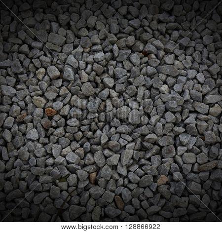 dark pebble stones.