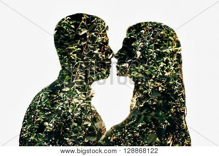 multiple exposure silhouettes of lovers on white background.