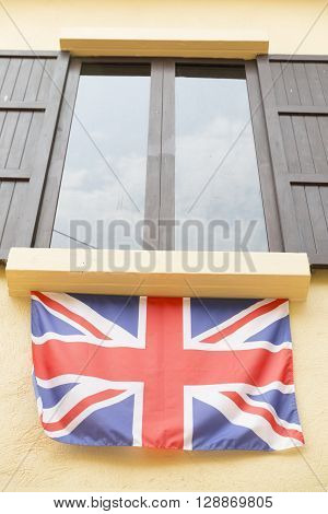 Wooden Window And Tinted Glass Decorating With United Kingdom National Flag