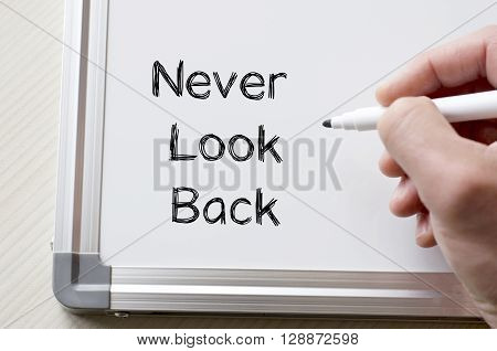 Human hand writing never look back on whiteboard