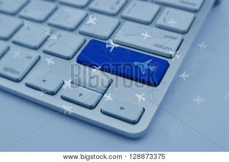 Airplane icon on modern computer keyboard button with world map and flight routes airplanes Airplane transportation concept Elements of this image furnished by NASA