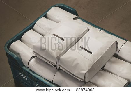 Closeup White Filled With Coffee Or Tea Kg Sealed Packages In Plastic Box On Concrete Floor In Wareh