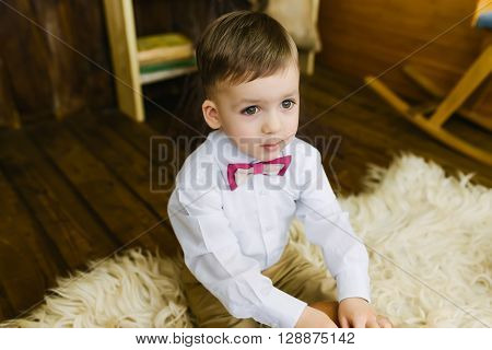 Boy sitting on the fur in a barn ** Note: Shallow depth of field