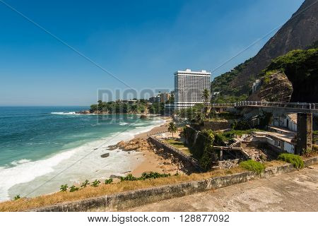 Rocky Coast of Rio de Janeiro with Mountais and Slum Vidigal