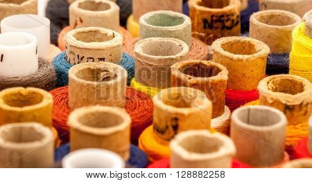 set of spools of thread can be used as background