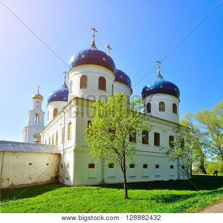 Cathedral of Exaltation of the Cross in Russian orthodox Yuriev male Monastery in Veliky Novgorod Russia in spring sunny day. Spring architecture landscape.