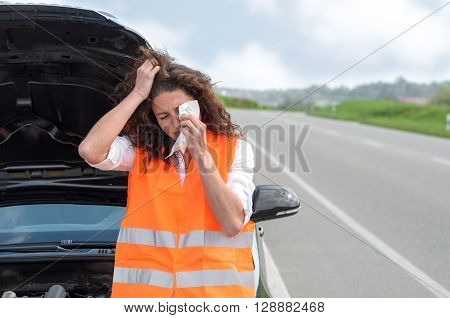 Upset Young Woman Crying After A Car Breakdown