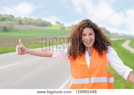 Smiling Confident Woman Hitching A Lift