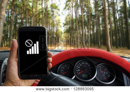 Male Hand Holding A Mobile Phone Which Shows No Signal Icon For Travel Concept