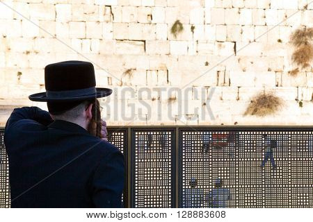 Jerusalem Israel - November 2 2010: An orthodox jew looking at the western wall