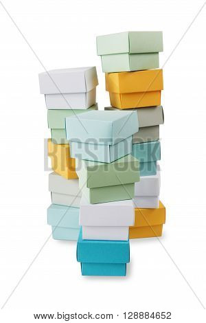 Several high stacks of multicolored boxes isolated on white background