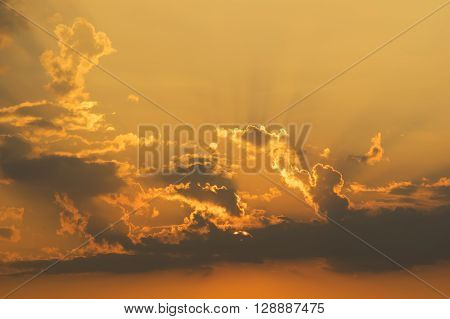 Orange sky with dark clouds at sunset