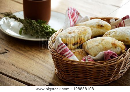 Savoury bread buns with herbs and dried tomatoes