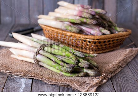 Fresh asparagus on a wooden background, close