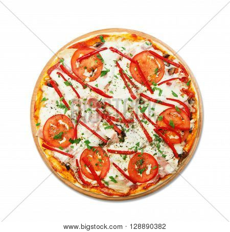 Delicious pizza with mushrooms, peppers and ham - thin pastry crust at wooden round desk and isolated at white background. Italian food. Top view