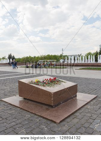 Moscow - May 6 2016: Flowers laid on a marble pedestal in honor of Victory Day in the Great Patriotic War on the main avenue of the Victory Park May 6 2016 Moscow Russia