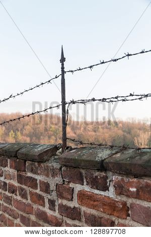 Red Brick Wall With Barbed Wire