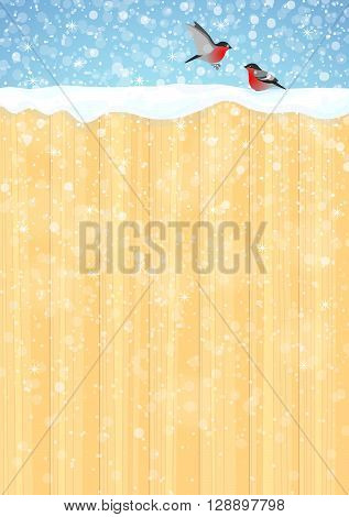 Winter background with wooden fence, bullfinches, blue sky and snowflakes