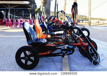 Pedal Cars for children and adults to ride on the beach rum