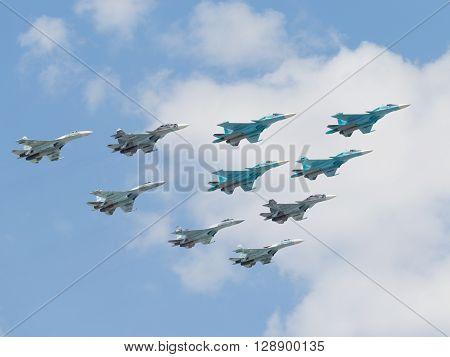 Moscow - May 7 2016 four Russian Su-34 multi-purpose fighter-bomber flying in the sky over Red Square on May 7 2016 Moscow Russia