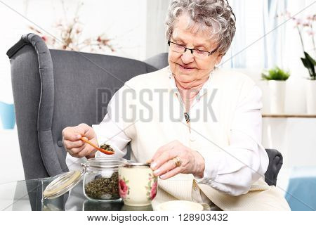 Grandma's herbs for colds. Brew of herbs, herbal medicine.